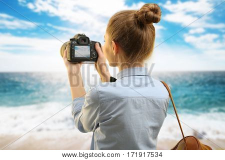 Photographer taking picture of beautiful seascape