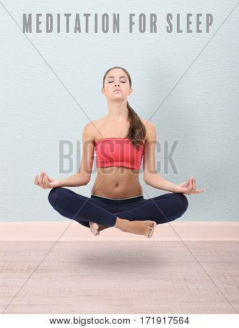 Concept of music for sleep and meditation. Young woman meditating in lotus pose
