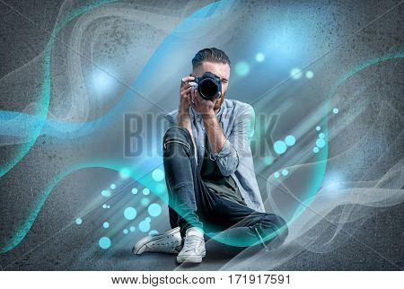 Professional photographer on gray background. Creative design