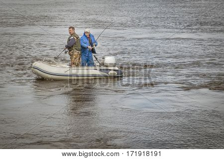 Minsk, Belarus - on May 21, 2016: a trip on the river Pripyat. Amateur fishing by trolling, men in the boat catch fish