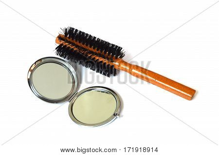 Pocket mirror with white background and wire comb pictures