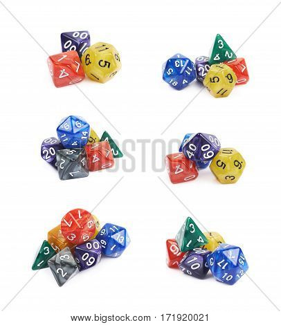 Pile of colorful roleplaying polyhedral dices isolated over the white background, set of six different foreshortenings