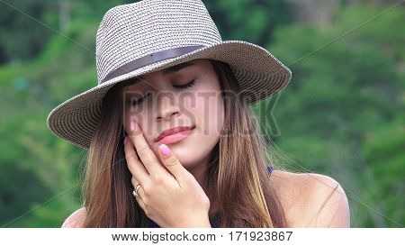 Tearful And Sad Teen Girl Wearing a Hat