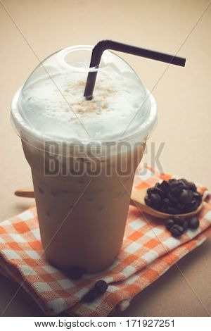 Frappucino on wooden table, Iced Coffee on wooden table