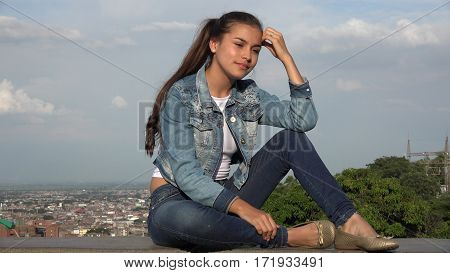 Teen Girl Sitting And Thinking Or Daydreaming