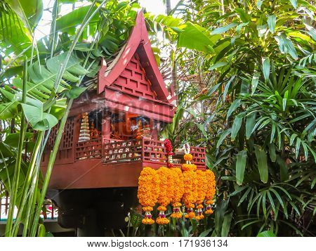 BANGKOK, THAILAND - JANUARY 17, 2014: The Jim Thompson House is the museum of Southeast Asian art. House altar in a tropical garden