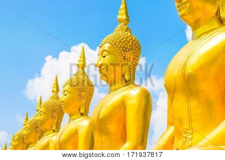 Buddha in thai temple with blue sky