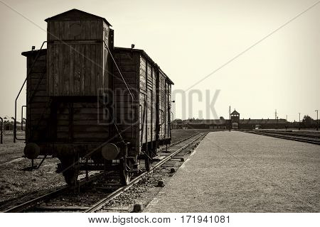 OSWIECIM POLAND - AUG 18:Main gate and railroad to concentration camp of Auschwitz Birkenau on August 18 2015 in Oswiecim Poland.