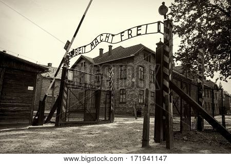 OSWIECIM POLAND - AUG 18: Arbeit macht frei sign in concentration camp Auschwitz on August 18 2015 in Oswiecim Poland.