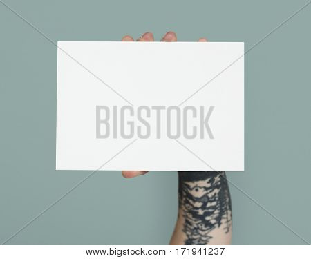 Tattoo Hand Holding Placard Isolated with Background