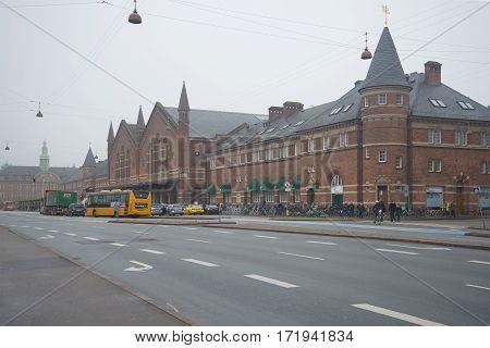 COPENHAGEN, DENMARK - NOVEMBER 01, 2014: View of the building of the railway station foggy November day