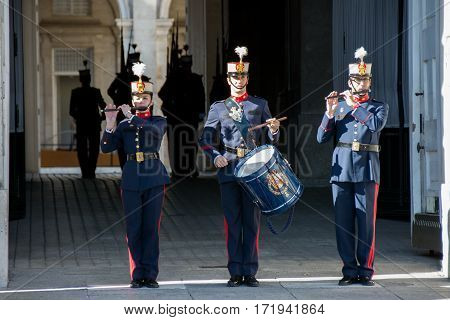 MADRID SPAIN - OCT 30: Royal Guards participate in the Changing of the Guard at Royal Palace on october 30 2013 in Madrid Spain.