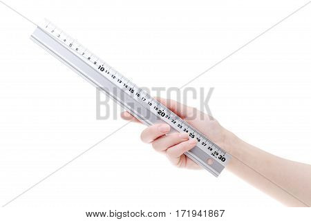 Hand holding metal ruler isoalted on a white background
