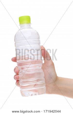 Hand holding bottle of water isolated on white background