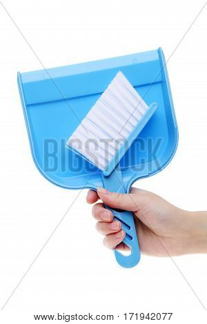 Hand holding dustpan isolated on white background