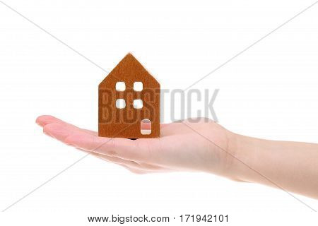 Miniature model of house on the hand isolated on white background