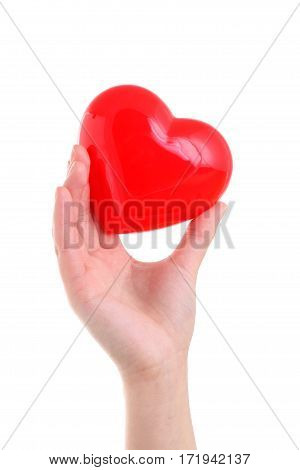 Hand holding red heart symbol isolated on white background
