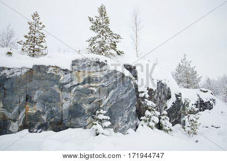 Gloomy January day in an old marble quarry. Ruskeala, Karelia