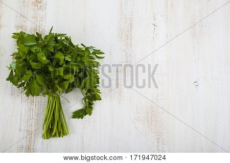 Fresh Parsley On A Light Wooden Background.