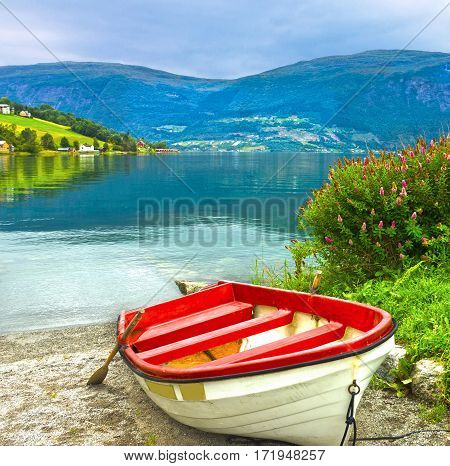 Boat on the beach, Norway fjords. Norwegian village Olden.