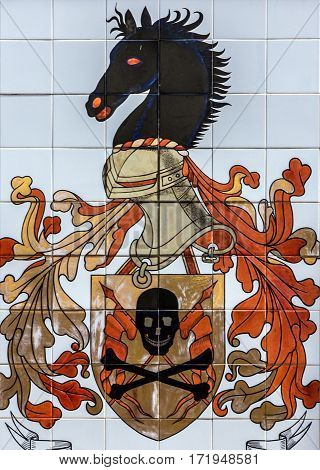 Lisboa, Portugal - Jan 18, 2017: Ceramic tile in Lisbon street, Portugal, emblem of fire brigade.