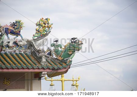 Dragon statue on roof with sky background. Traditional Chinese style art