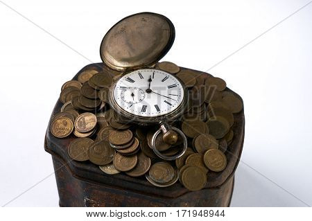 Time is money concept a bunch of coins with a pocket watch on top of Vintage jewelry box isolated on white.