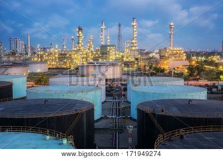 Oil and gas refinery factory with oil tank and steel pipe chemical process and energy concept.