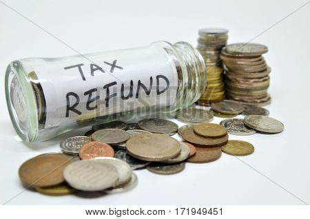 Tax Refund Lable In A Glass Jar With Coins Spilling Out