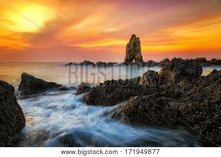 Sea wave hit the rock at sunset in Pattaya Thailand Phuket Phi Phi