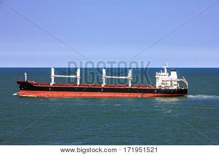 Cargo bulker ship sailing in sea water