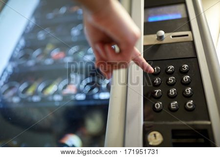 sell, technology and consumption concept - hand pushing button on vending machine operation panel keyboard poster