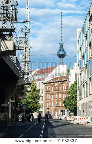 BERLIN. GERMANY - AUGUST 01 2016: A view of the TV tower modern constructions and graffiti in the center of Berlin.