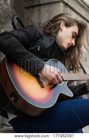 Guitar Player Playing Song Outdoor