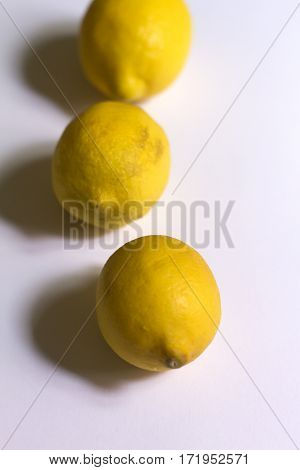 Three beauty yellow lemon on neutral background