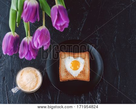Still Breakfast For A Loved One With Tulips On A Dark Background