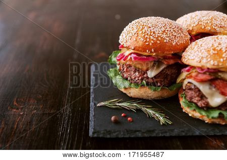 A Delicious And Juicy Burger Home In A Rustic Style With A Big Chop Of Beef