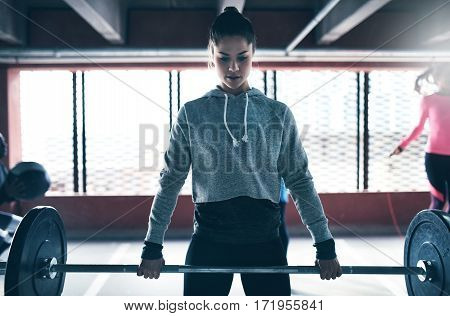 Young Strong Girl Lifting Weights