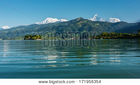 The Machapuchare and Annapurna range seen from Phewa Lake in Pokhara, Nepal