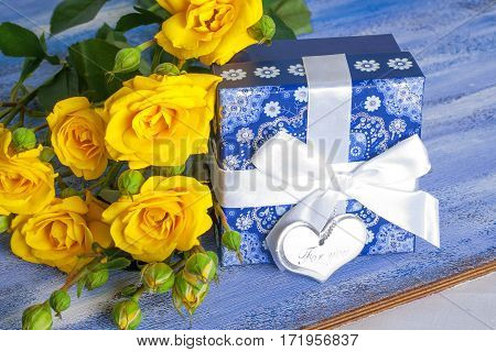 Blue Present Box And Yellow Roses On Wooden Tray