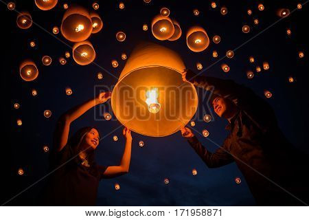 sweetheart and valentine Family Thai people floating lamp in Yeepeng festival