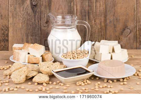 Soy products on wooden background