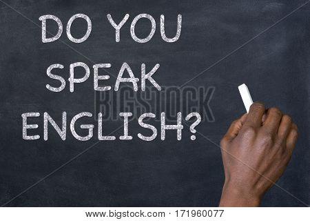 Question 'Do you speak English?' written on a blackboard