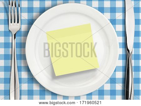 Table setting with blank note sticker on plate