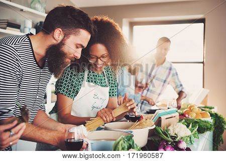 Group Of Friends Making Dinner