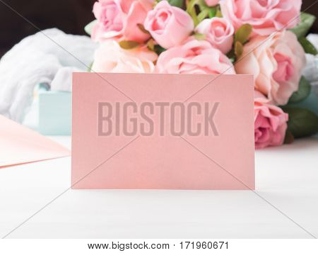 Blank pink paper card for Valentine's or mother woman day. Wedding baby birthday romantic date invitation. Background with roses