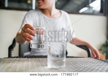 Glass of very cold water in girl's hand transparent glass. Quench their thirst.