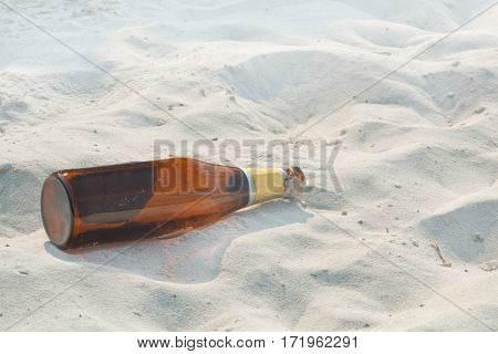 The bottle lying on a deserted beach