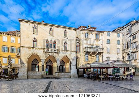 Scenic view at historic city hall in town Split at square Pjaca, famous sightseeing spot in Croatia, Europe.