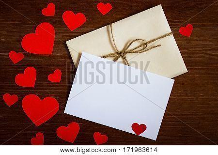 White paper card on wooden background on valentines day